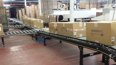 Interroll modular conveyor platform implemented for Paul & Shark automated warehouse.